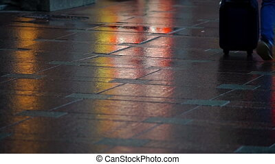 Many pedestrians walking at pavement - Close-up view of...