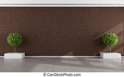 Empty room with stucco wall brown and two indoor plants -...
