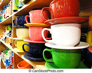 Coffe Mugs on Store Shelf - View of many coffee mugs on...