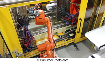 Factory Robotics - High angle shot of a robotic arm reaching...