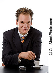 Businessman drinking coffee - Businessman drinking at coffee...