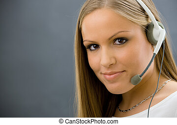 Operator talking on headset - Studio portrait of young...