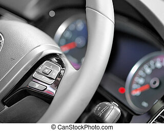 Close up of steering wheel commands in modern luxurious car
