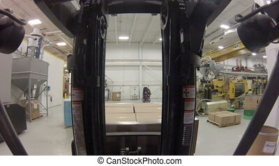 Factory Forklift POV - Point of view shot from inside a...