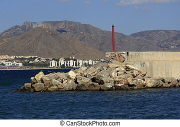 lighthouse and small fishing port in the town of Mazarron, Spain