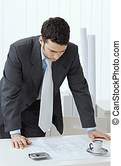 Architect working - Architect wearing grey suit leaning on...