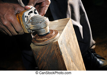 Carpenter using wood sander - Closeup of carpenter using a...