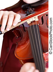 girl plays on violin by bow isolated - girl plays on violin...