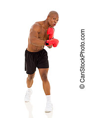 african man boxing - strong african man boxer with red...