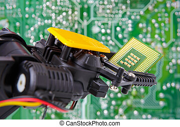 Robot arm holding chip circuit board background