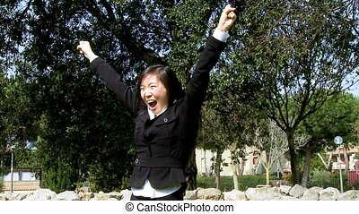 Shouting for success - Dolly shot on asian girl shouting for...