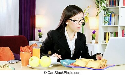 Asian woman working at home - Young asian business woman at...