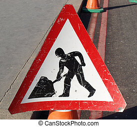 Road work sign isolated on a street border