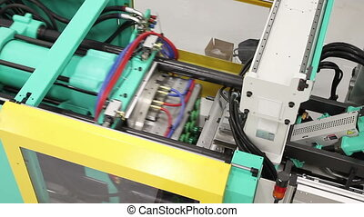 Crane Down on Factory Machinery - Moving downward, over a...