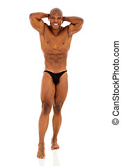 young african bodybuilder posing on white background
