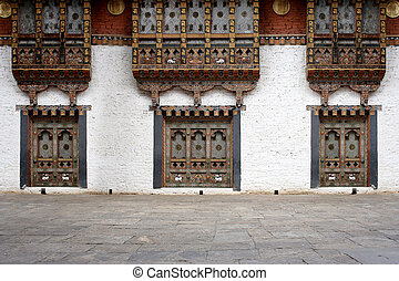 Bhutanese windows in the Temple of Bhutan.