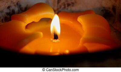 Orange flower like candle close up - Close up of the yellow...