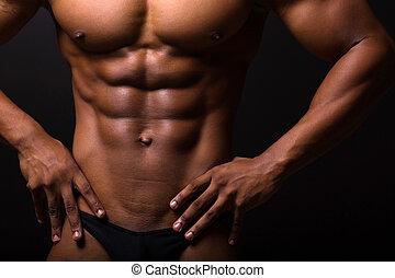muscular african man 6 packs - closeup of muscular african...