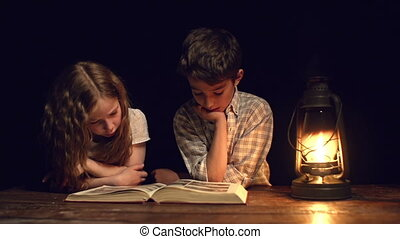 Insomnia - Handheld shot of children staring at the book...
