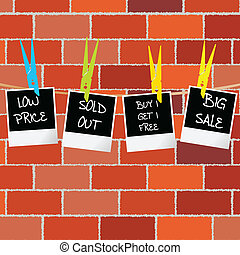 Photo frames with sale and promotional advertisement against wall background