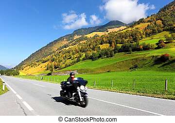 Among the hills motorcyclist rides - Great Highway in...