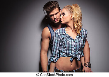 woman looking with passion at her boyfriend , studio shot on...