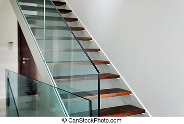 hardened glass balustrade in house - detail of hardened...