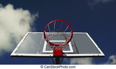 Basketball hoop with cage with clouds time lapse footage in...