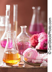 alchemy and aromatherapy set with ranunculus flowers and...