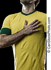 Brazilian soccer player, listening to the national anthem...