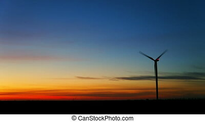 Wind turbine at sunset timelapse