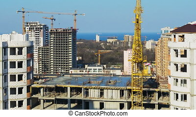 Timelapse of building under construction. Crane lifts the...