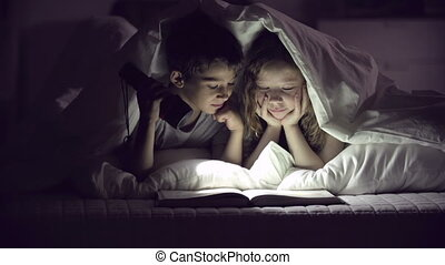 Book Lovers - Children with flashlight reading