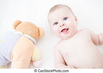 Baby girl - Cute baby girl playing on a white blanket