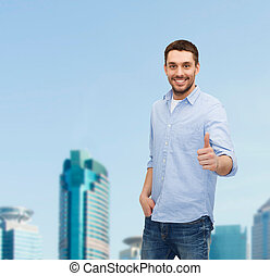 smiling man showing thumbs up - happiness, gesture and...