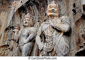 Giant stone representation of a Bodhisattva and Guardian of...