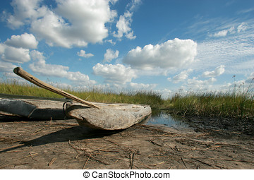 Mokoro boat on a riverbed - Mokoro boat on a river bed.