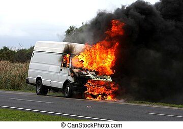 Burning Vehicle Disastor - Delivery type vehicle on side of...