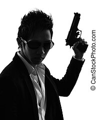 asian gunman killer portrait silhouette - one asian gunman...