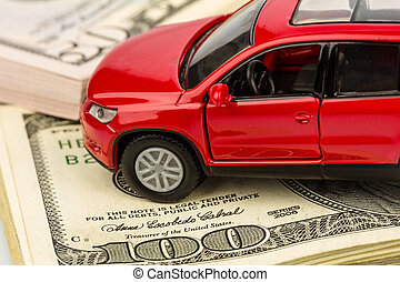 car on dollar bills - a car stands on dollar banknotes. cost...