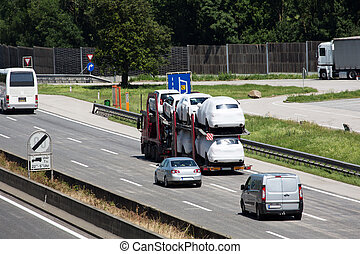 trucks on the highway - trucks on a three-lane motorway...
