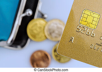 credit card and empty wallet - a golden credit card and an...