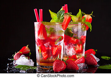 Summer drink - Summer strawberry drinks on black stone,...
