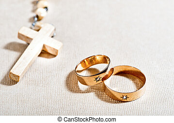 Wedding Rings and Cross - still life with wedding rigs aand...