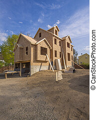 New house under construction - A single family home under...