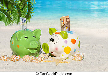 Two Piggy banks with banknotes on the Beach