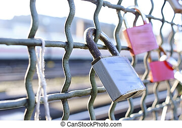 Love Locks - The close up of locks from loving couples on a...
