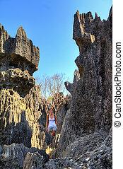 Tsingy woman - Beautiful woman stands among the sharp peaks...