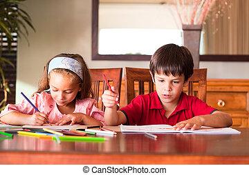 Children doing homework at home