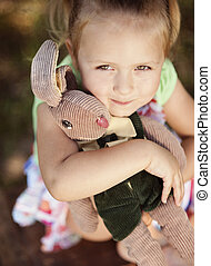 Cute little girl with toy - Outdoor portrait of cute little...